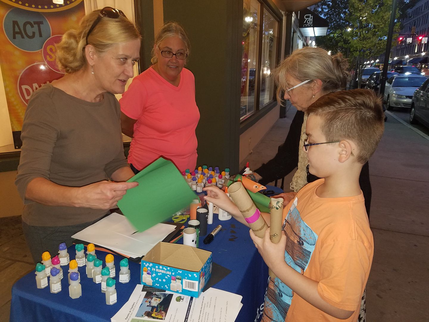 Outreach's Community Advisory Board members enjoy First Friday activities with a child in downtown Scranton.